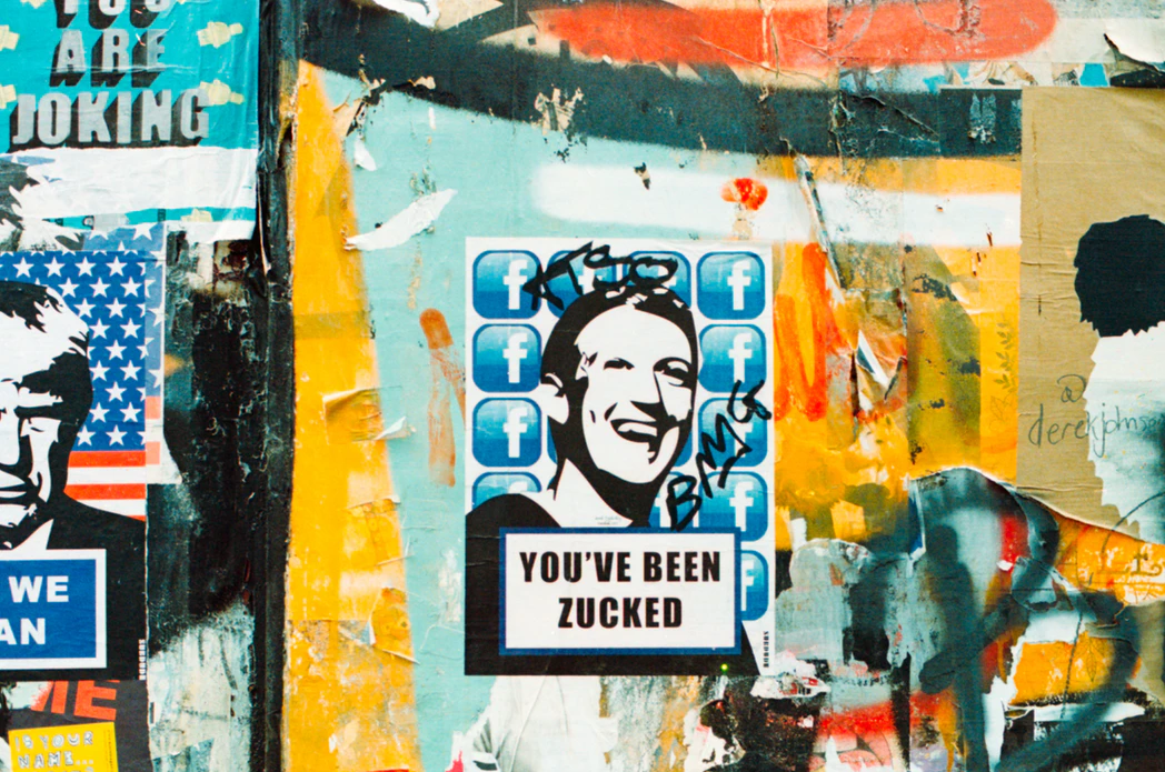 "Social Media Graffiti with Mark Zuckerberg's face and text that says ""You've Been Zucked"""