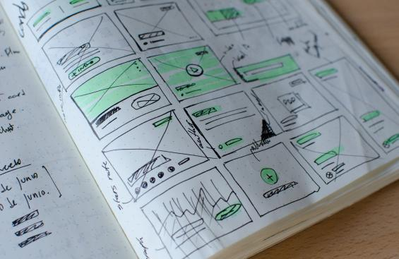 Sketch of wireframes on white paper.