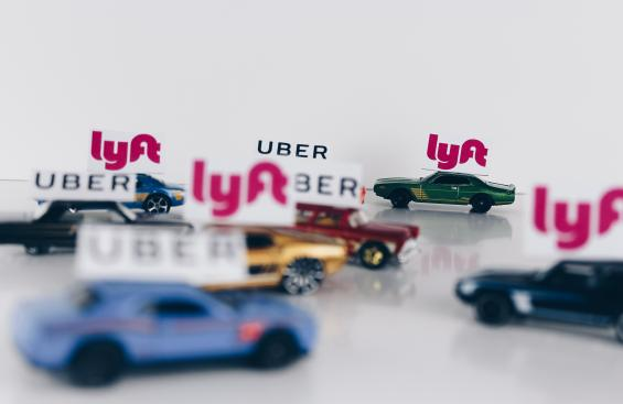 Image of toy Uber and Lyft cars driving around