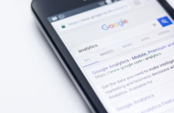 "Smartphone showing a search for ""Analytics"" on Google"